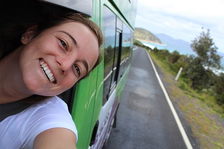 girl-travel-with-jucy-campervan-on-road