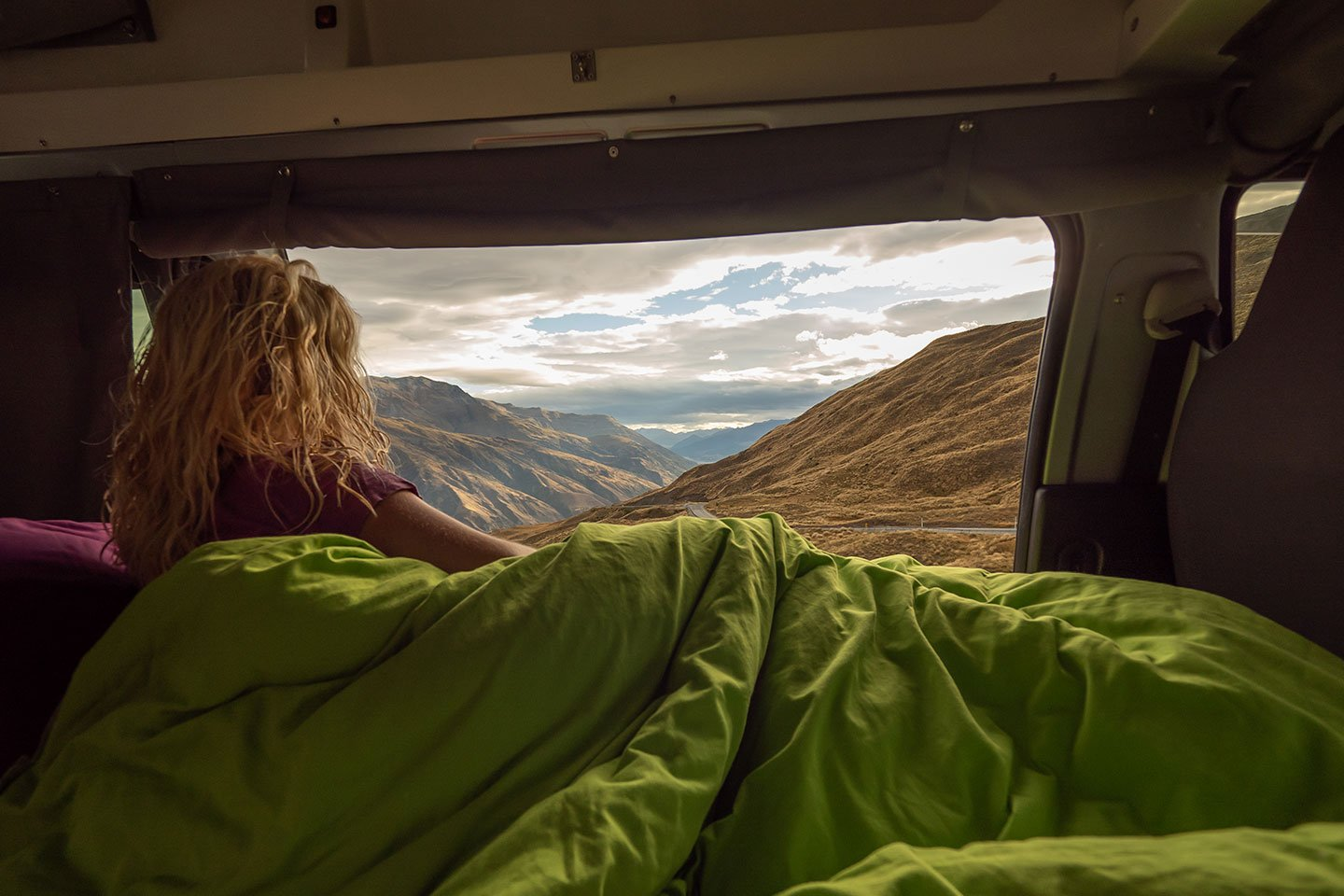 woman wakes up at stunning view in condo